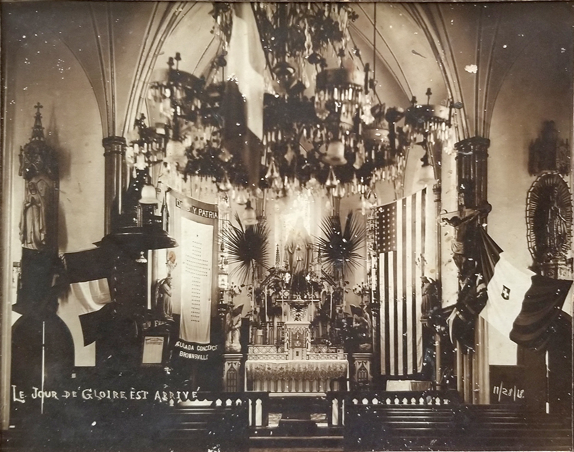 "Historic photo of the interior of the Immaculate Conception Cathedral. Brownsville, Texas. Cameron County. ""Le Jour Glorie est arrive. 11/28/1918."""